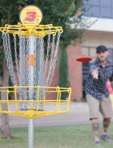 Through the Chains: CU students regularly enjoy the game of disc golf on campus.