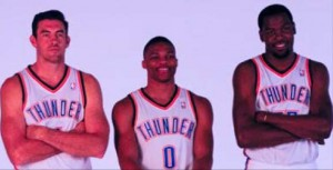 Thundering up: The team gets together for the first time before camp to talk about the upcoming season. Players posed with flags, basketballs and silly faces at media day.