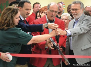Grand opening: Jeri Mosiman, Nathan Johnson, Nick Preston and Rodney Bivens cut the ribbon at the opening of the Lawton Food Bank's new location. The new building opened at 3 p.m. on Nov. 9.