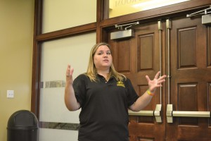 Leading the way: Student Activities Specialist Leslie Cothren addresses the audience at the last CU Leadership Academy for the semester. The event addressed how student organization officers interact with faculty advisors.