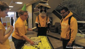 The hunger: Students cut the cake on Ole Kim's birthday. The event took place Nov. 5 in the MCC.