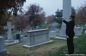 Sound the bugle: Music junior Joseph Kinsman plays at the Arlington National Cemetery. The 50th anniversary for JFK's funeral was held on Saturday, Nov. 16, with Kinsman playing the bugle along with 99 others.