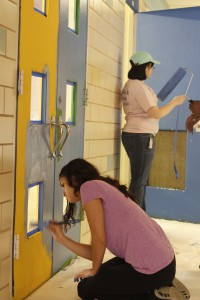 A day on: Victoria Roman (below) sophomore Criminal Justice major and Taylor Hutton (above) senior Communication major paint doors on MLK Day.