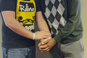 CU P.R.I.D.E. holding strong: Two CU students hold hands as a demonsration of their support for the same-sex marriage ban in Oklahoma to be overturned.