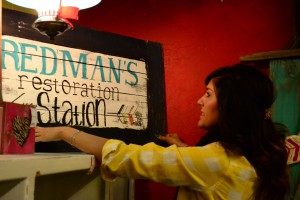 Building her dream: Shailah Redman arranges one of her handpainted signs for her new business.