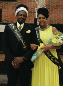 Lyndel Monrose and Karin Clashing-O'Reilly, both representing Students of the Carribean Alliance, pose for pictures after being crowned Homecoming King and Queen for 2014.