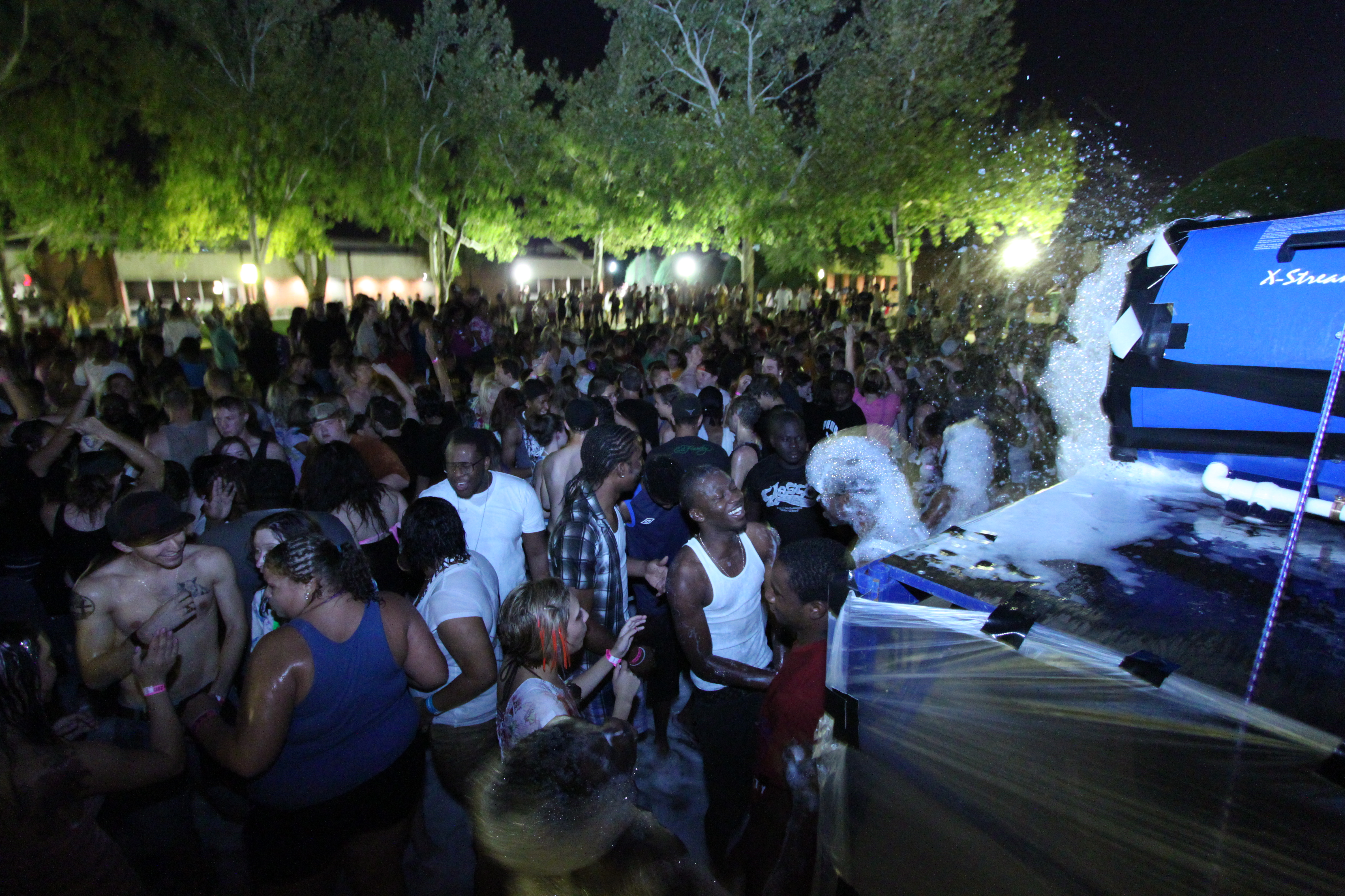 Courtesy photo: Groups of students crowd around the Fine Yards Courtyard during the Foam Dance Party. The event, which had been at Cameron for nearly a decade, was discontinued for the Fall 2014 semester.