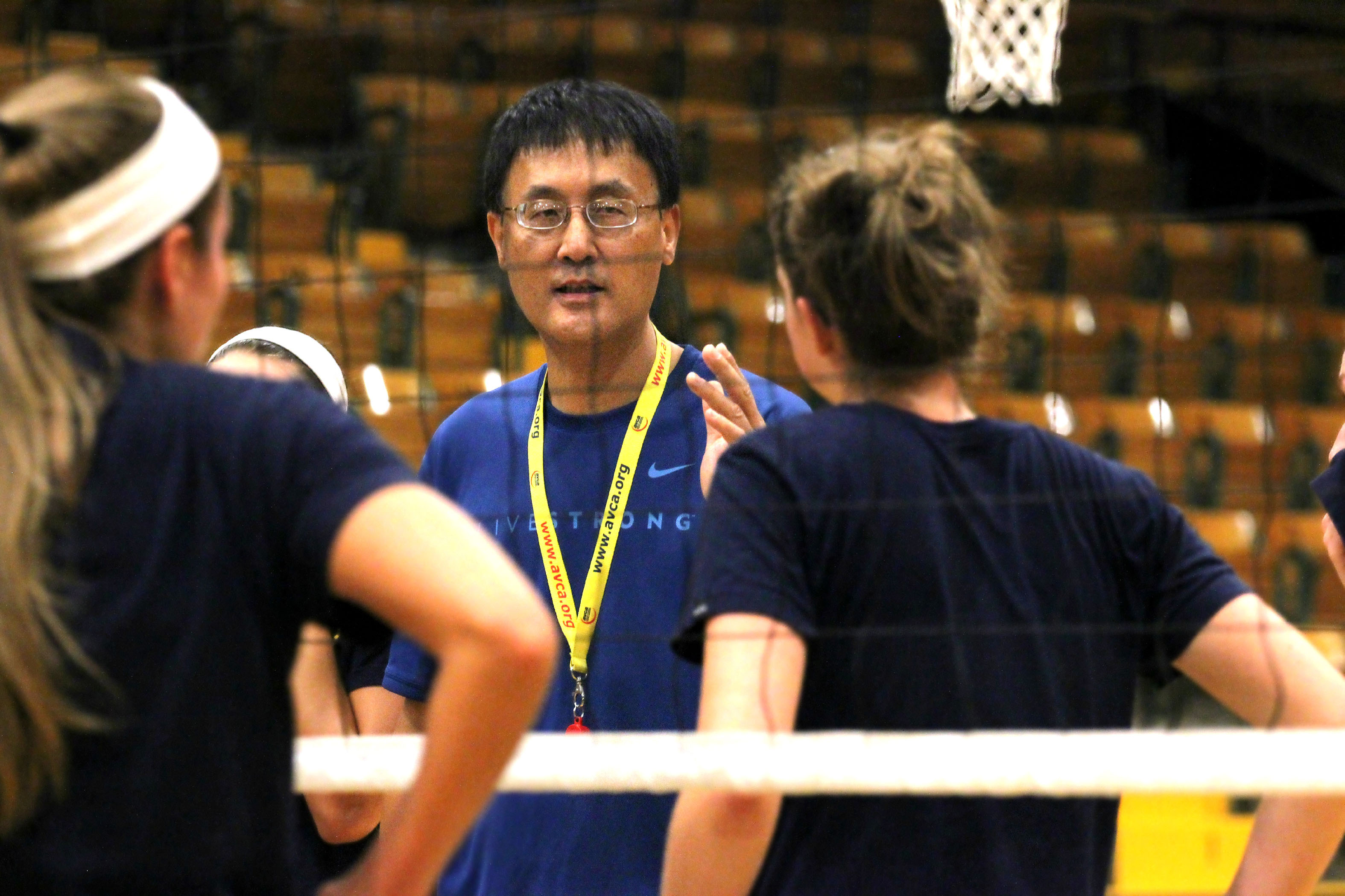 Photo by: Krista Pylant Head Coach Qi Wang of the Aggie volleyball team gives instructions to his players. This season is Wang's first at the helm of the team.