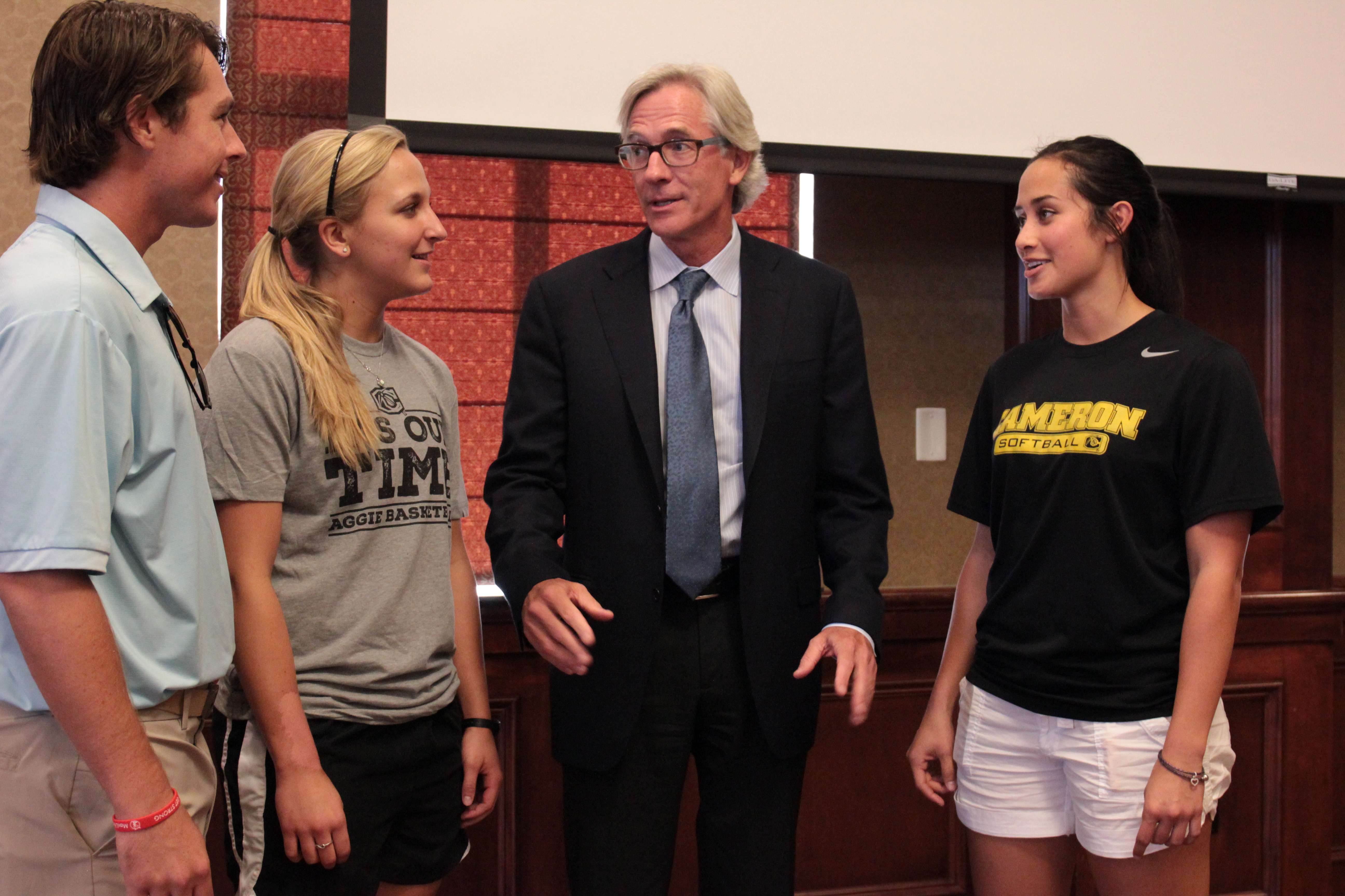Dr. Brian Hainline speaks with student-athletes